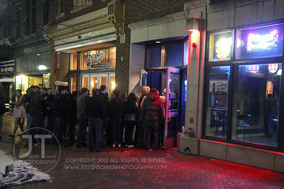 A crowd lines up for entry to The Library Nightclub, 113 E. College St in Iowa City late Saturday night. Copyright Justin Tor...
