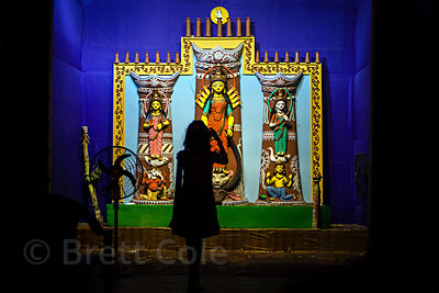 A girl photographs a Durga Puja pandal in Lake Gardens, Kolkata, India.
