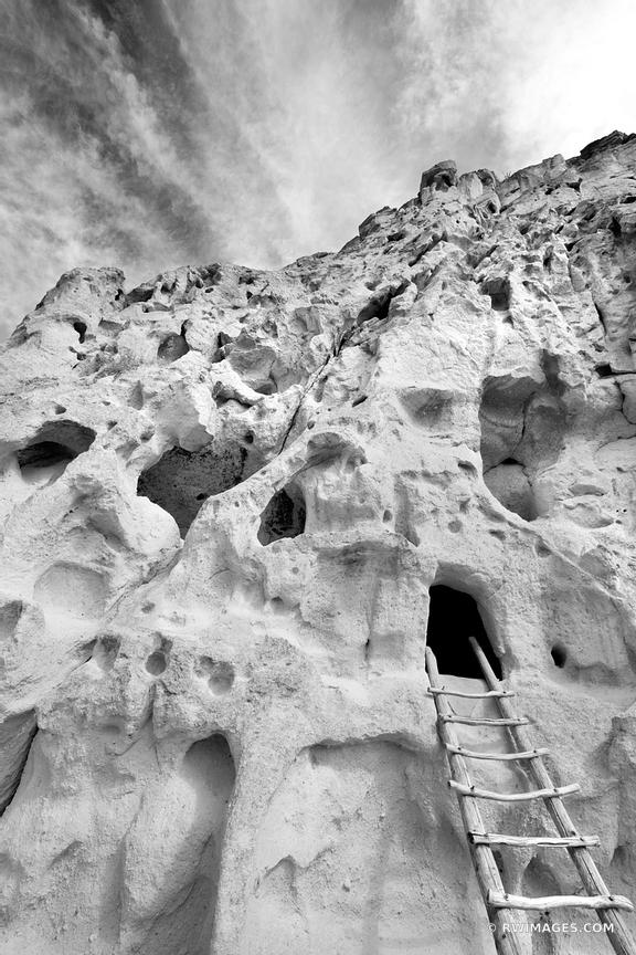 ANCIENT NATIVE AMERICAN CLIFF DWELLINGS BANDELIER NATIONAL MONUMENT NEW MEXICO BLACK AND WHITE VERTICAL