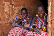 Maasai women in a mud hut in the manyatta, Kenya