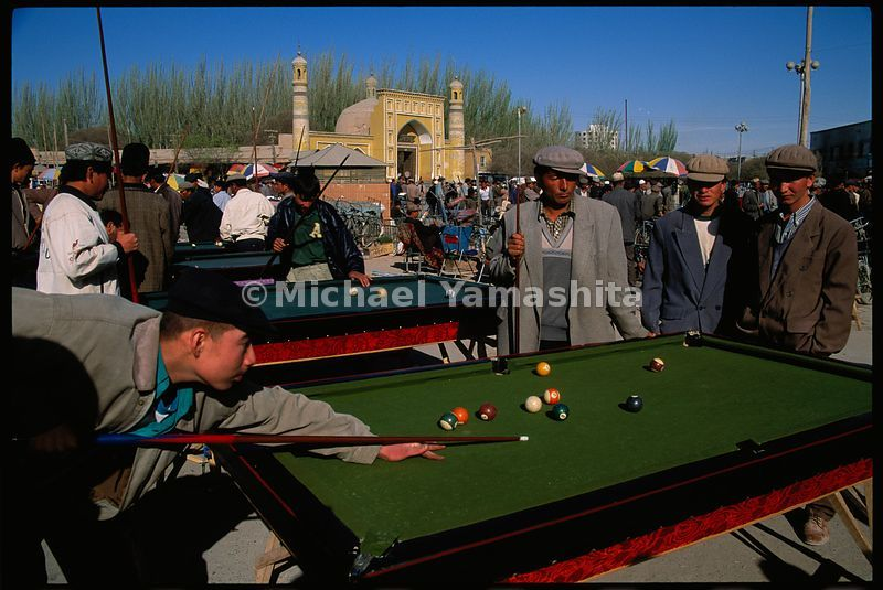 The market in Kashgar is not just buying and selling: the billiards tables are a center of attraction.