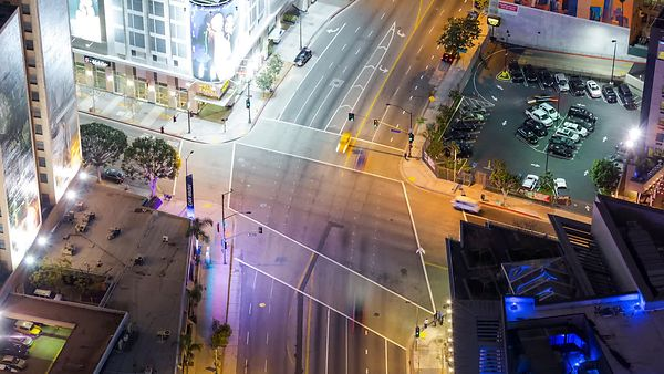 Bird's Eye: Tight Shot of a Neon Intersection in Downtown L.A. at Night