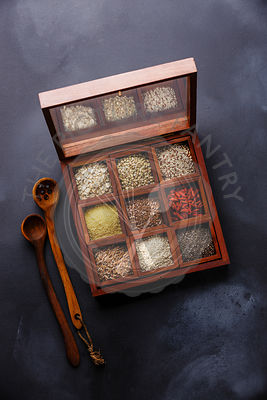 Superfoods and cereals selection in wooden box: oat, buckwheat, quinoa, bulgur, flax seed, goji berry, polba, sesame and chia...