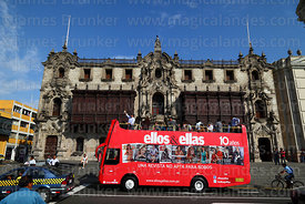 Ellos & Ellas magazine open topped double decker bus in front of Archbishop's palace, Lima, Peru
