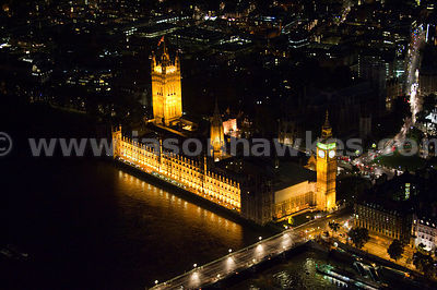 Aerial view over Houses of Parliament at night, London