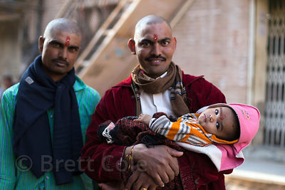 A family of Hindu pilgrims with shaved heads, Pushkar, Rajasthan, India
