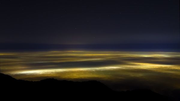 Bird's Eye: Medium Shot Of Mist & Stratus Clouds Covering A Lit Up Los Angeles Basin