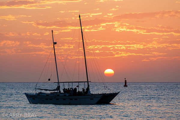 Sailing boat against setting sun in Santa Marta, Columbia, South America