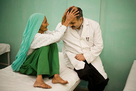 India - Ghaziabad - Doctor Rajendra is blessed by a patient