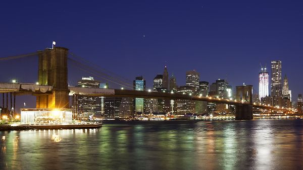 Close Up: Brooklyn Bridge Leading To Manhattan During Sunrise (Night to Day)