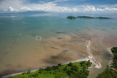 Aerial view of river mouth, coast, traditional fishing nets and islands, Camarines Sur, Pacific Coast, Luzon, Philippines 2008