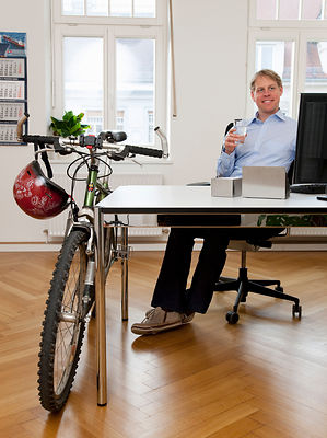Businessman in office with bicycle