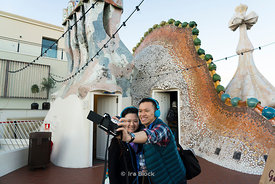 Tourists taking selfies on the roof of Casa Batllò in Barcelona, Spain.