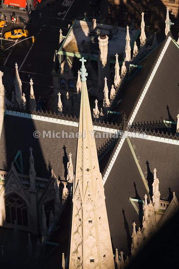 The spires of St. Patrick's Cathedral are like sentries standing at attention over Fifth Avenue.  Manhattan, New York City.