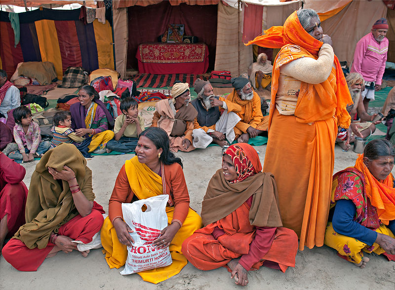 Pilgrims wait for langar (communal meals) during the kumbh mela, Allahabad.