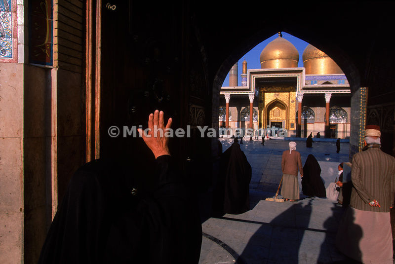 At dawn, worshippers enter Khadimain Mosque in Baghdad