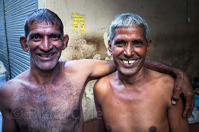 Brothers working for a chile dealer at the Khari Baoli spice market, Delhi, India