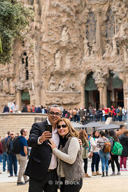 Tourists taking selfies outside Sagrada Família church in Barcelona, Spain