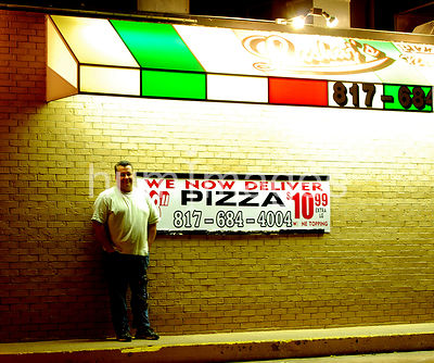 Pizzeria owner standing outside his pizza restaurant in Euless, Texas