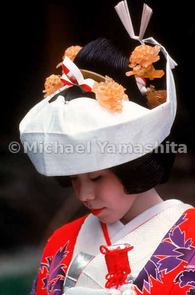 Three Ages of the Japanese Woman - a girl from Matsushima, a bride wearing the elaborate kimono and headpiece for the Shinto ...
