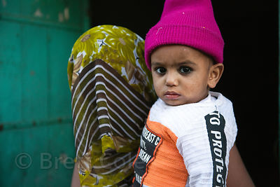 A Muslim woman, her face obscured, poses with her child, Jodhpur, Rajasthan, India