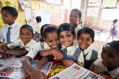 A group of girls read newspapers during free time at a school in Varanasi, India operated by Dutch NGO Duniya (duniya.org)