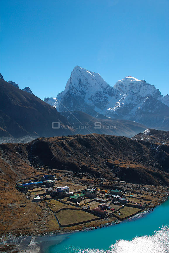 NEPAL Gokyo Peak -- A view of Gokyo - largely a collection of lodges rather than a village - from Gokyo Ri, with Mount Cholat...