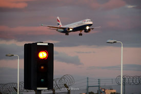 A British Airways plane landing at Heathrow Airport in London, UK.