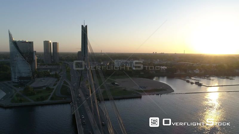 Aerial drone shot of suspension bridge during sunset in Riga, Latvia