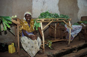 woman selling vegetables in the market, Tororo, Uganda