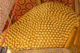 Intricate gold leaf decoration of the Reclining Buddha at the Wat Pho temple complex in the Bangkok.