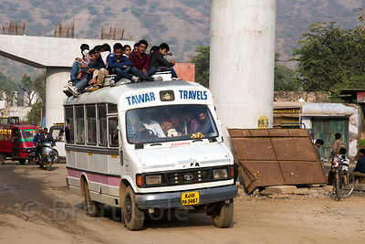 School students travel on top of a small bus, Gandhi Nagar, Ajmer, Rajasthan, India