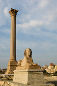 Pompey's pillar and one of the two sphinxes, Alexandria, Egypt