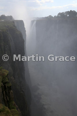 Victoria Falls smoking and thundering, looking west along the First Gorge, Zimbabwe and Zambia
