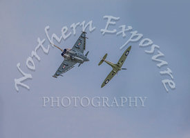 A RAF Typhoon Eurofighter GGR.4 with a Spitfire mkIIa forming the Battle of Britain 75th anniversary commemorative flight. Th...