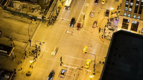 Bird's Eye: Traffic & Foot Traffic At A Busy Intersection