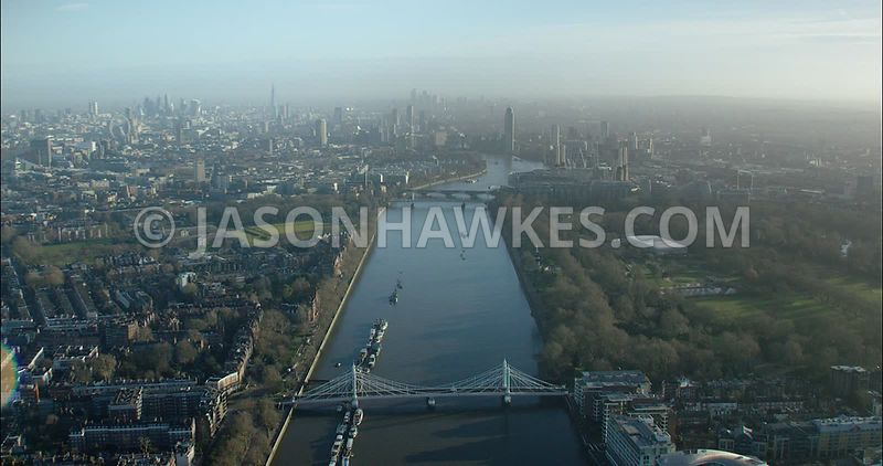 London Aerial footage, River Thames at Albert Bridge towards Chelsea Bridge.