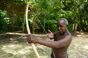Akamba man with bow and arrow, Ngomongo Village, Kenya