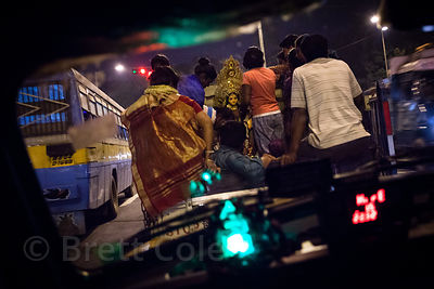 View of a Lakshmi idol being transported to Babughat by truck for immersion during Lakshmi Puja. Kolkata, India. Taken from i...