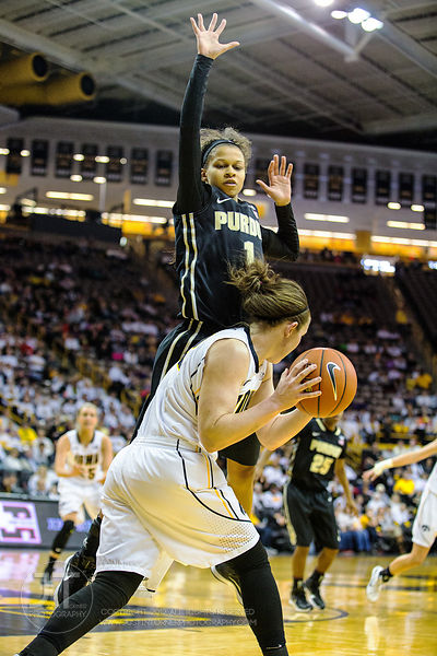 Purdue's Ashley Morrissette (1) defends Iowa's Samantha Logic (22) during the second half of play at Carver-Hawkeye Arena in ...