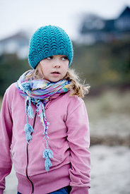 Little Danish girl in a blue hat at the beach in autumn 11