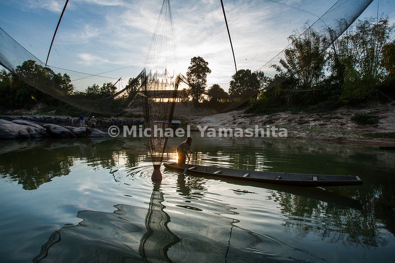 Giant dip nets on Hue Luang River at sunset.