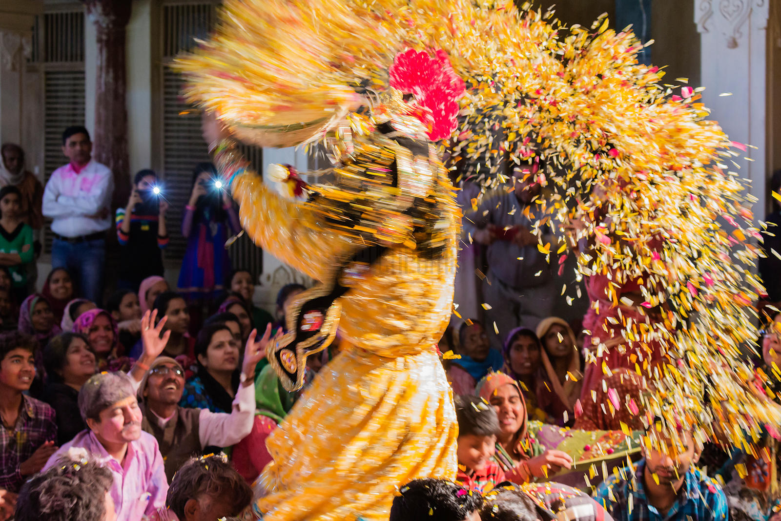 Reveller Throwing a basket of Petals at a Holi Celebration