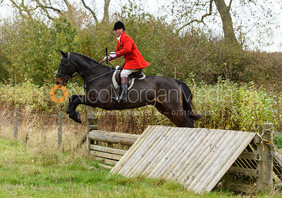 Major Tim Brown jumping a hunt jump near Peake's. The Cottesmore Hunt at Somerby