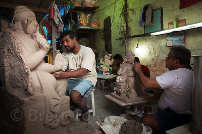 Sculptors in the village of Colaba, Mumbai, India craft idols of Ganesh for the Ganesh Chaturthi festival.