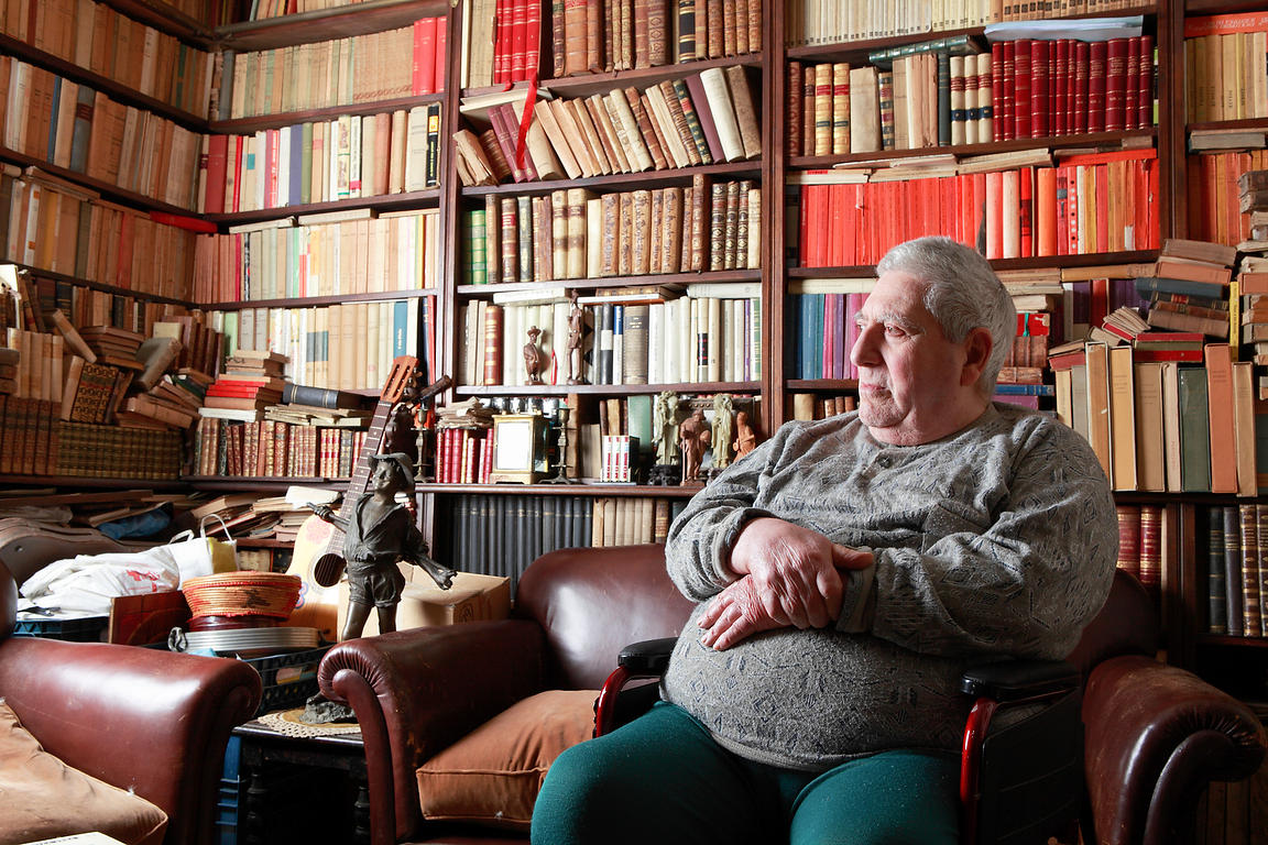 Bookseller at home among books