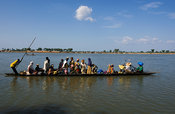 Djenné is situated on an island in the Niger Inland Delta. People cross the water to surrounding villages by pirogue, Mali