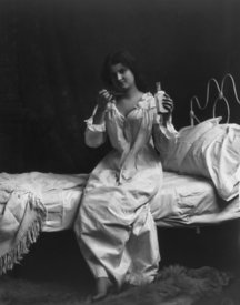 Woman taking medicine ca. 1900-10