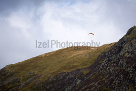 Paragliders taking off from the rocky mountain summits of the Derwent Fells in the English Lake District.