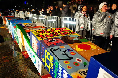 The individually painted dominos  topple by Former Polish President Lech Walesa along the route of the former Berlin Wall  in...